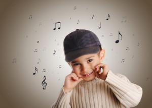 boy with denim cap singing