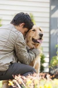 Boy with dog at home backyard