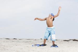 Boy with swim gear at the beach