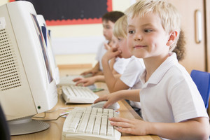 Boy working on a computer at primary school