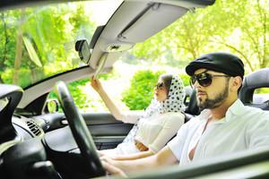 Boyfriend and girlfriend having fun in a car