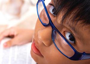 Brainy School Kid Reading A Book