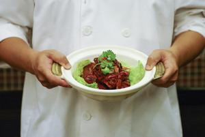 Braised pork on chef hand