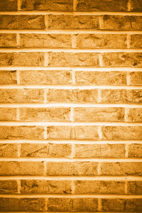 Brick wall background in black and white with vignetting.