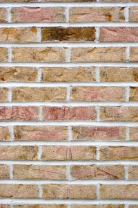 Brick wall background with one single brick standing out as different.