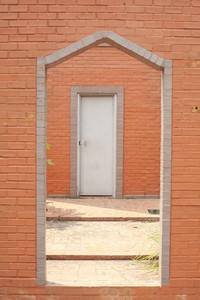 brick wall & barred door