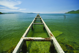 Broken bridge to the emerald sea