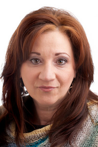 Brunette middle aged woman with red bronze hair.