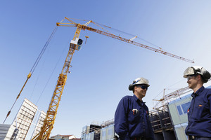 building workers and mobile cranes