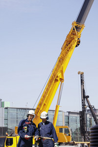 building workers and surveying