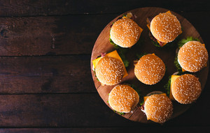 Burgers On The Wooden Background