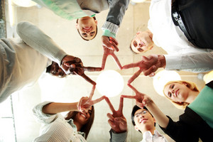 Business and succcess concept - group of businesspeople showing v-sign together