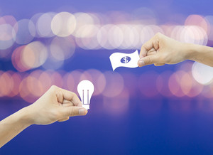 Business concept Hand hold white paper idea and money bokeh background.