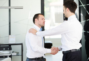 Business handshake after signing new contract