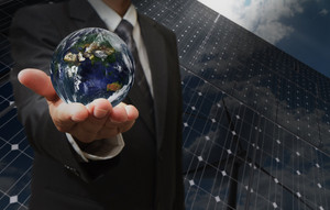 Business Man Hand Shows The Earth