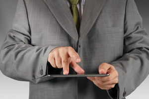 Business Man Hand Working On A Digital Tablet