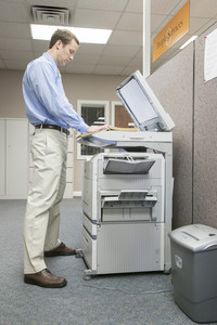 Business people with copy machine