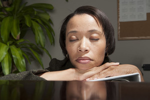 Business person asleep in office