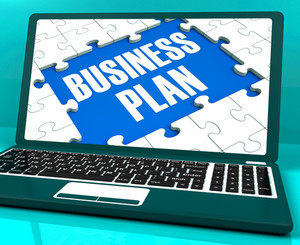 Business Plan On Laptop Showing Solutions Management