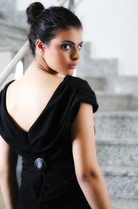 Lady on black dress look back