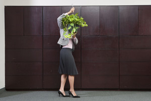 Business woman caring for plant