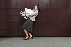 Business woman carrying files