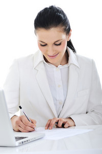 Business woman on desk signing documents