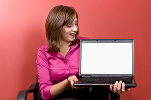 Business woman with a laptop - clipping path for the screen area isolation is included.