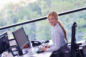 Business woman working on her desk in an office