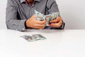Businessman counting hundred dollar bills