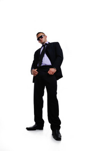Businessman full length isolated on white with hands in pockets