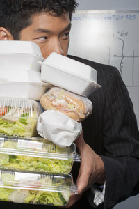 Businessman hoarding food