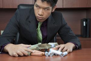 Businessman hoarding money