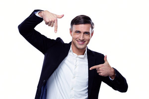 Businessman in formalwear gesturing finger frame over white background