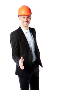 Businessman in helmet offering handshake over white background