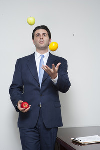 Businessman juggling fruit