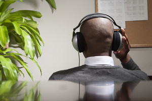 Businessman listening to music in office