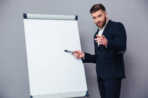 Businessman presenting something on blank board