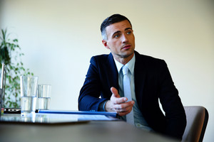 Businessman sitting at the table and explaining something