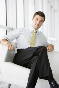 Businessman sitting in office lobby