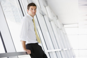 Businessman standing in corridor