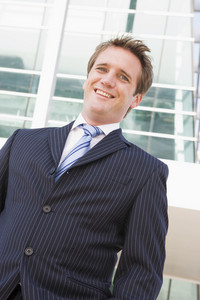 Businessman standing outdoors smiling