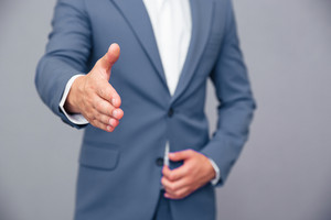 Businessman stretching hand for handshak