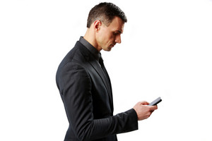 Businessman using smartphone isolated on a white background