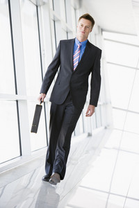 Businessman walking in corridor