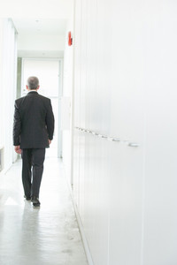Businessman walking in hallway