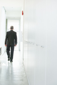Businessman walking in hallway