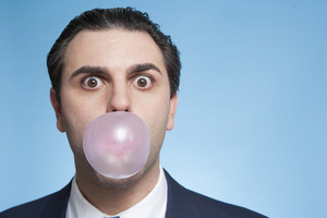 Businessman with bubblegum