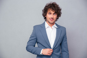 Businessman with curly hair looking at camera