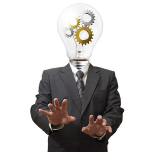 Businessman With Gears In Light Bulb Head